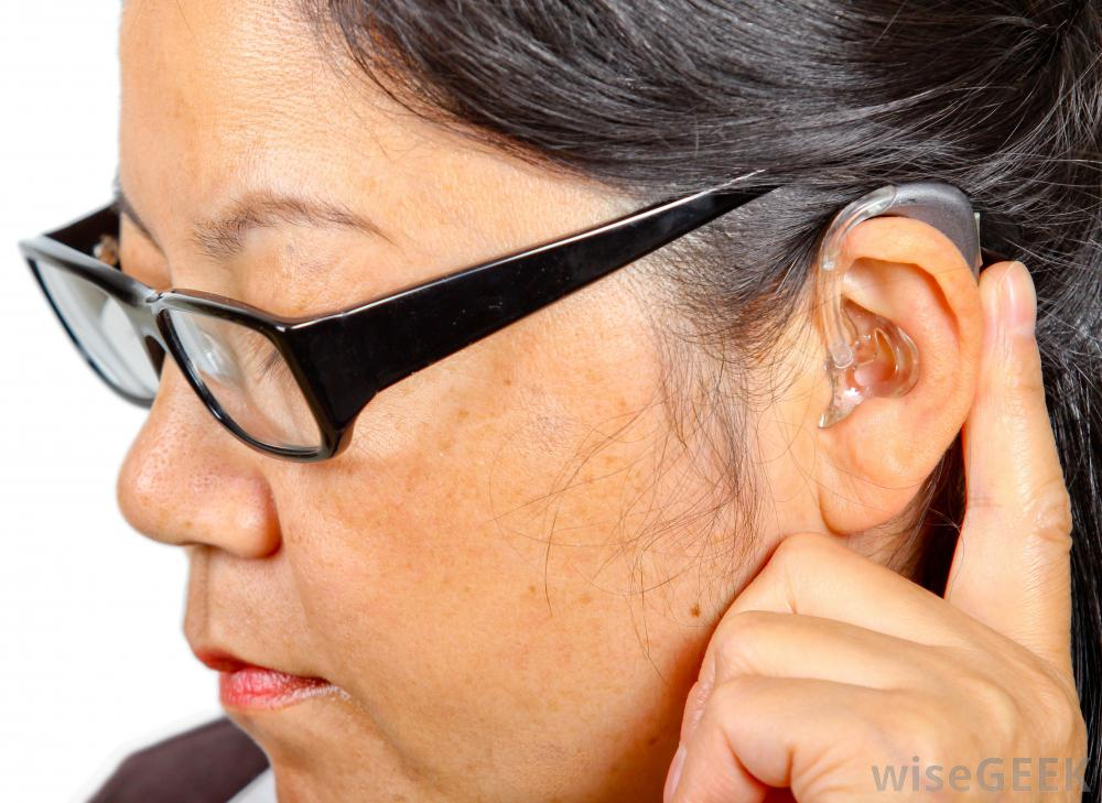 woman-with-glasses-with-hearing-aid